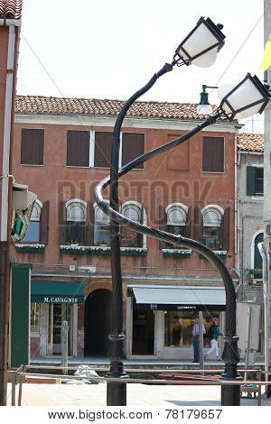 Interlaced Poles On The Venetian Island Of Murano