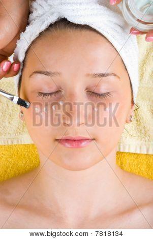 Applying Cream On Face At Salon