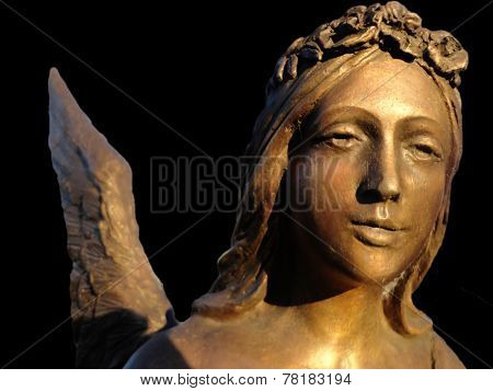 Angel's Bronze Sculpture. Face Close-up; Isolated On Black