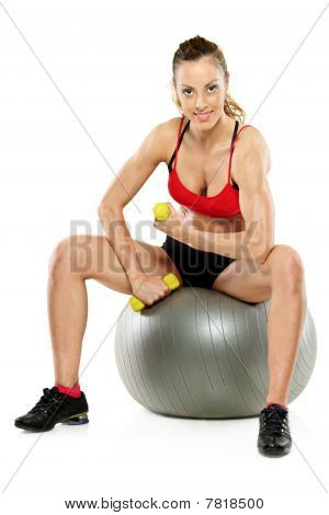 A female working out with a dumb bell