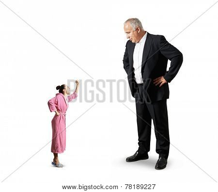 big senior man looking at small angry woman. isolated on white background