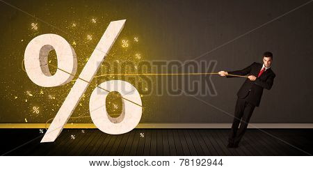 Business man pulling rope with big procent symbol sign concept on background
