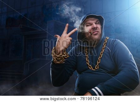 Angry man, sitting with a cigarette