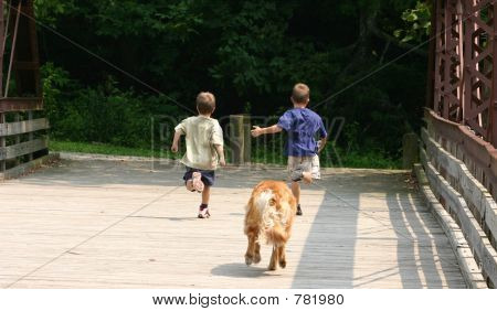 Boys Running with Dog