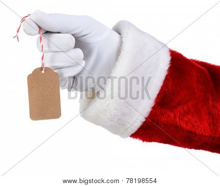 Closeup of Santa Claus hand holding a blank gift tag over a white background. Only Santa's white gloved hand red suit are shown.