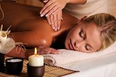 stock photo of massage therapy  - professional masseur doing massaging female neck in the beauty salon - JPG