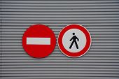 stock photo of street-walker  - sign prohibiting pedestrian access on metal wall - JPG