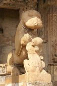 stock photo of kandariya mahadeva temple  - Lion and young woman statues at Kandariya Mahadeva Temple at Khajuraho in India Asia - JPG