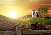 pic of red barn  - Red barn and tractor on a farm with the sun rising over the horizon - JPG