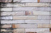 stock photo of old stone fence  - Old stone wall with a pattern for the background - JPG