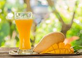 picture of fruit-juice  - Fresh mango juice and mango fruit on the table - JPG