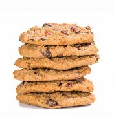 picture of baked raisin cookies  - Stack of homemade cranberry oatmeal raisin cookies on white background - JPG