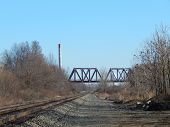 stock photo of trestle bridge  - a train trestle that goes over another set of railroad tracks - JPG