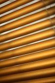 foto of jalousie  - Daylight through brown metal jalousie in closeup - JPG