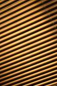 pic of jalousie  - Closed brown metal jalousie background in closeup - JPG