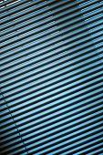 pic of jalousie  - Metal jalousie background in blue toning in closeup - JPG