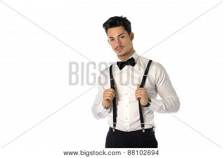 Handsome elegant young man with business suit, suspenders, isolated