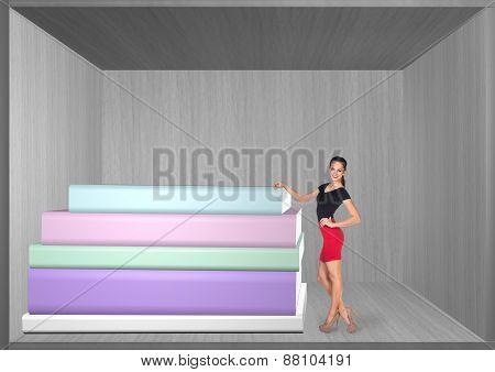 Pretty woman standing on book shelf