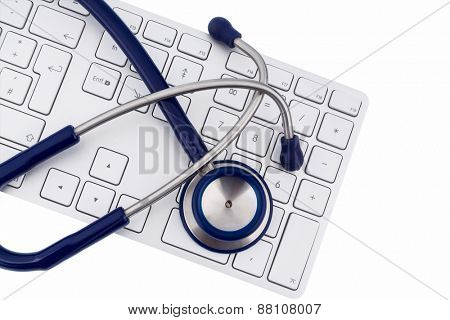 stethoscope and keyboard of a computer, symbolic photo for diagnosis and appointment management