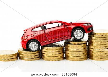 car on coins. symbol photo for costs