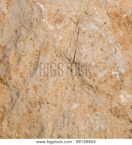 Uneven stone background texture with crack