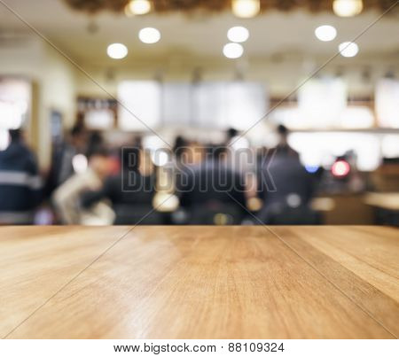 Table top with blurred Bar with people and Interior background