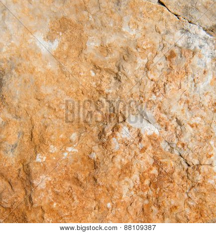 Stone background texture with uneven surface and crack