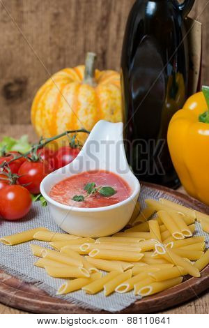 Tomato Sauce In A White Sauce Boat With Fresh Ingredients