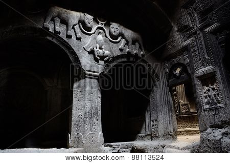 The Hall Of Ancient Christian Temple Geghard With ,Columns, And Bas-relief Depicting Lions, Armenia
