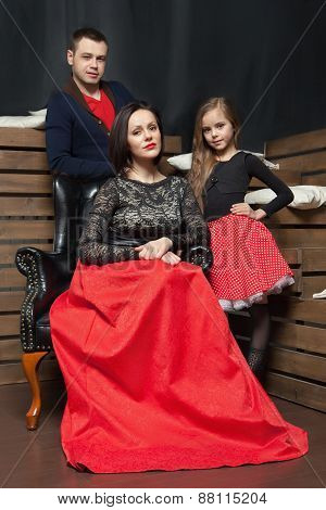 Portrait of young family wearing elegant