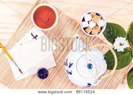 asian set of tea on wooden table. View from above.