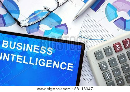Tablet with business intelligence , graphs and calculator.