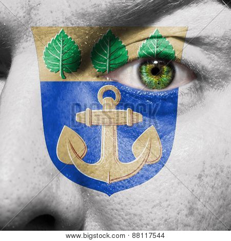 Mariehamn Flag Painted On A Man's Face To Support His City