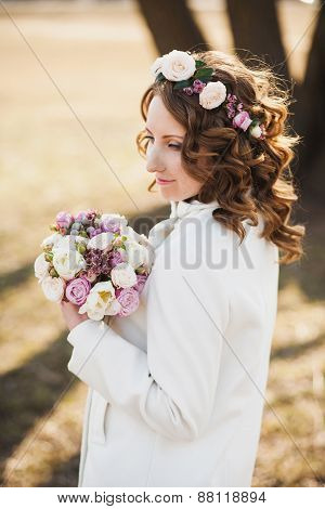Beautiful Young Woman With Delicate Flowers In Hair