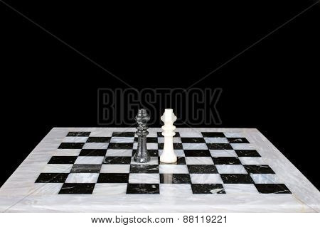Who is the winner. King vs king on a marble chess board