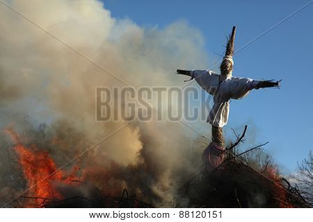 BURG, GERMANY - APRIL 7, 2012: Straw doll symbolizing winter is burned at the traditional Easter bonfire in the Lusatian village of Burg in Spreewald Region, Lower Lusatia, Brandenburg, Germany.