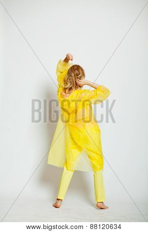girl back in yellow