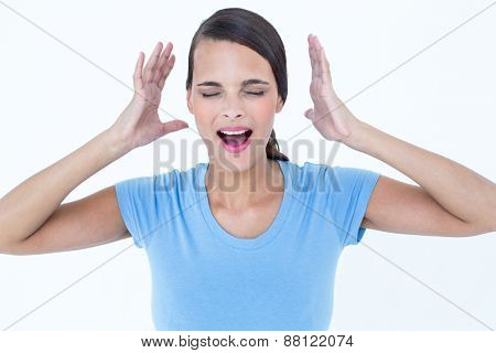 Stressed woman raising her hands around her head on white background