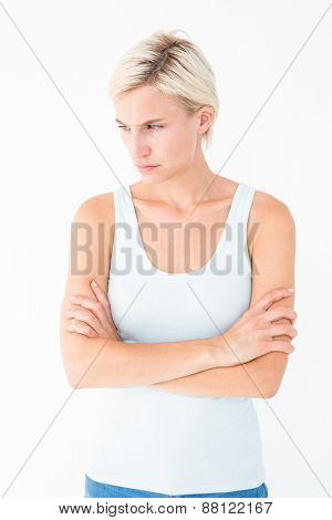 Angry blonde with arms crossed on white background