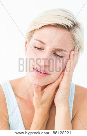 Pretty blonde with tooth pain on white background