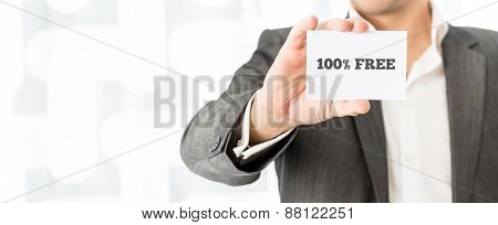 Salesman Showing A White Business Card With 100% Free Sign