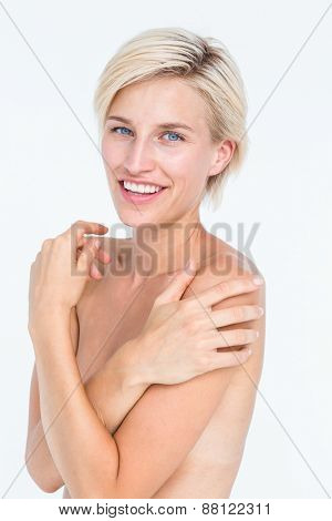 Peaceful woman touching her neck on white background