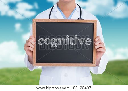 The word cognitive and doctor showing little blackboard against field and sky