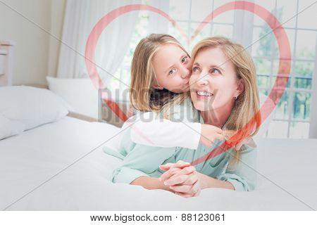 Heart against cute girl kissing her smiling mother