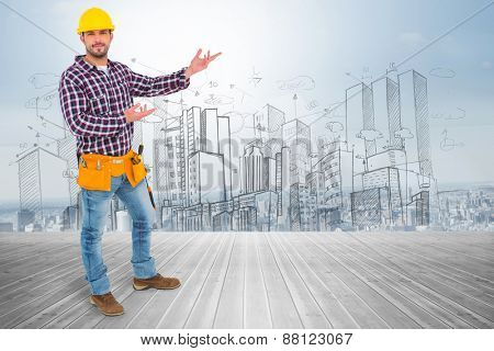 Handyman showing something against room with large window looking on city