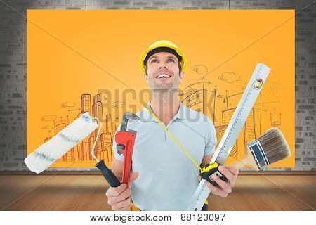 Worker holding various equipment over white background against composite image of orange card