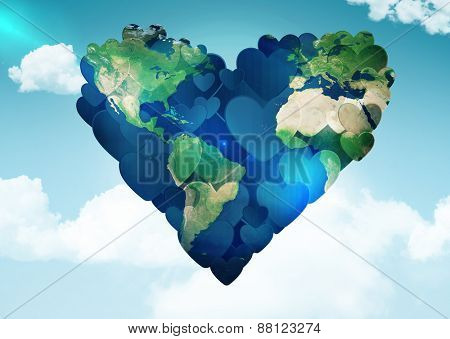 Heart shaped earth against blue sky