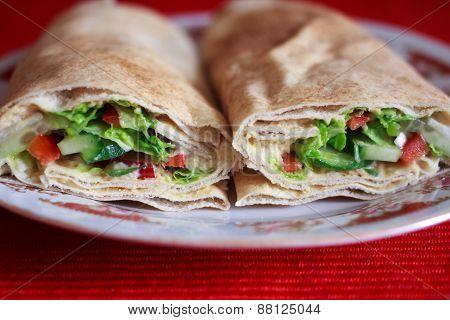 Vegan pita and humus wraps with vegetables