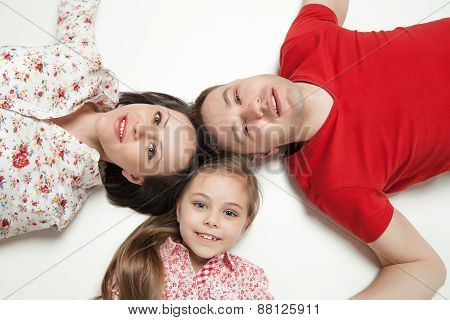 High angle portrait of happy family lying