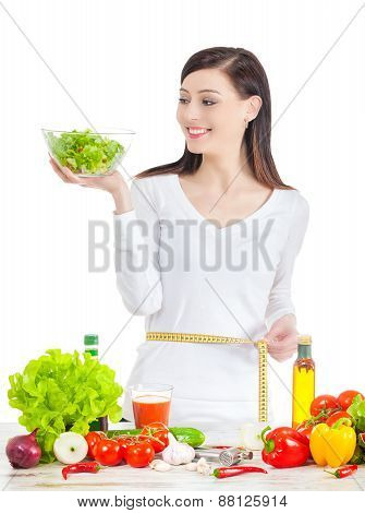 Young Happy Woman With Salad Measuring Her Waistline.